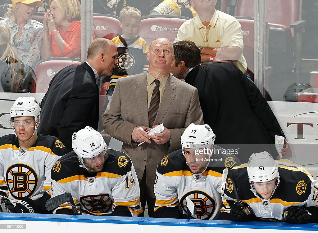 Head coach Claude Julien of the Boston Bruins looks at the scoreboard near the end of the third period against the Florida Panthers at the BB&T Center on April 9, 2015 in Sunrise, Florida. The Panthers defeated the Bruins 4-2.