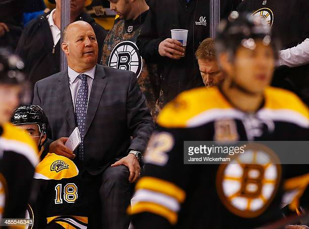 Head coach Claude Julien of the Boston Bruins looks in the third period against the Detroit Red Wings in Game One of the First Round of the 2014 NHL...