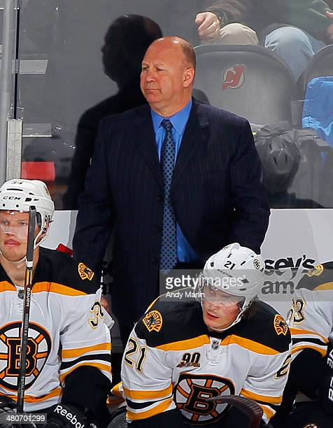 Head coach Claude Julien of the Boston Bruins looks on during a timeout against the New Jersey Devils during the game at the Prudential Center on...