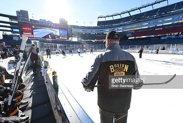 Head Coach Claude Julien of the Boston Bruins looks on during team practice as part of the 2016 Bridgestone NHL Classic at Gillette Stadium on...