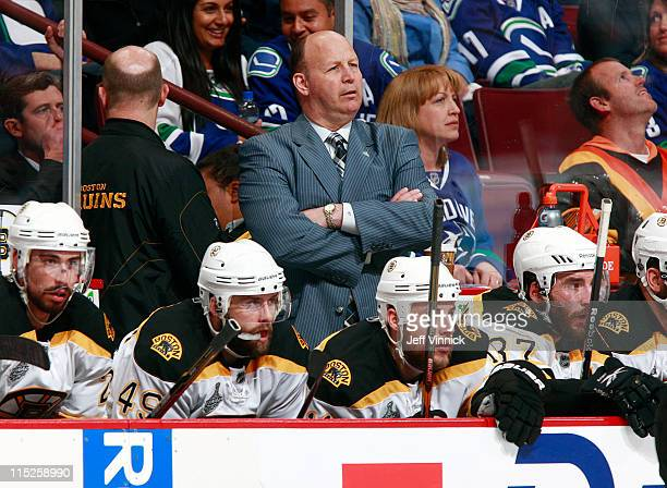 Head coach Claude Julien of the Boston Bruins looks on from the bench during Game One of 2011 NHL Stanley Cup Finals against the Vancouver Canucks at...