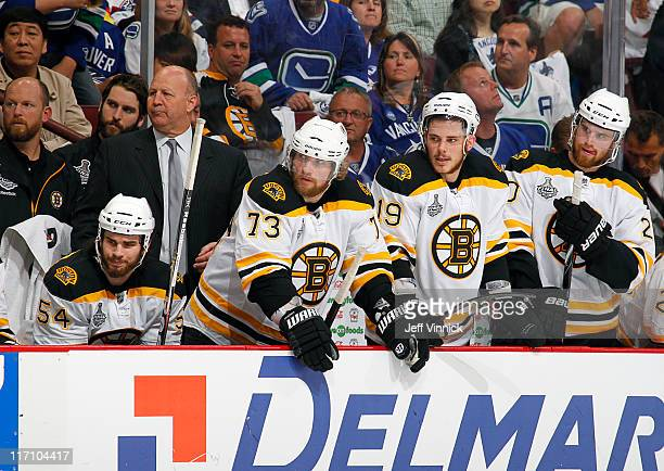 Head coach Claude Julien of the Boston Bruins looks on from the bench during Game Seven of 2011 NHL Stanley Cup Final against the Vancouver Canucks...