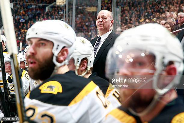 Head coach Claude Julien of the Boston Bruins looks on from the bench during their NHL game against the Vancouver Canucks at Rogers Arena February 13...
