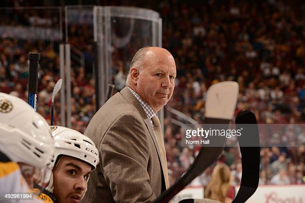Head coach Claude Julien of the Boston Bruins looks on from the bench during a stop in play against the Arizona Coyotes at Gila River Arena on...