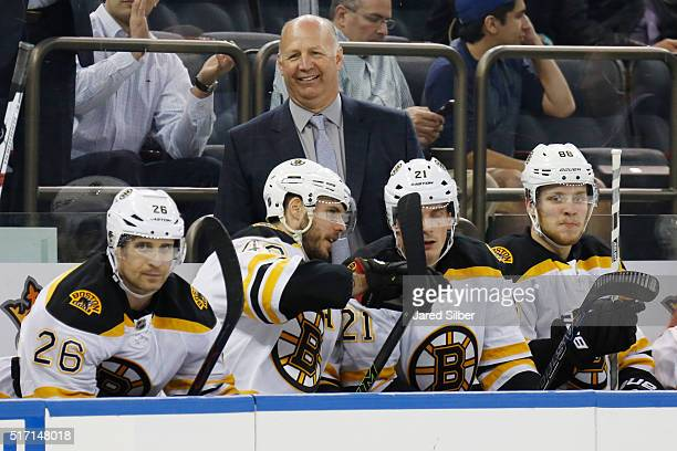 Head coach Claude Julien of the Boston Bruins looks on from the bench in the first period against the New York Rangers at Madison Square Garden on...