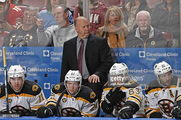 Head coach Claude Julien of the Boston Bruins looks up ice during third period action against the Florida Panthers at the BBT Center on January 7...