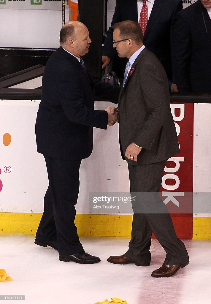Head coach Claude Julien of the Boston Bruins shakes hands with head coach Dan Bylsma of the Pittsburgh Penguins after the Bruins defeated the Penguins 1-0 in Game Four of the Eastern Conference Final during the 2013 Stanley Cup Playoffs at TD Garden on June 7, 2013 in Boston, Massachusetts.