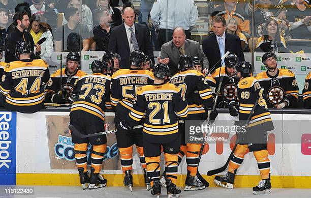 Head Coach Claude Julien of the Boston Bruins talks to his team during a time out against the Montreal Canadiens in Game Five of the Eastern...