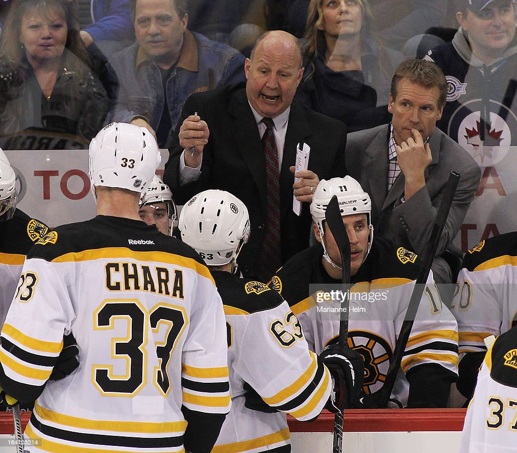 Head coach <a gi-track='captionPersonalityLinkClicked' href=/galleries/search?phrase=Claude+Julien&family=editorial&specificpeople=582124 ng-click='$event.stopPropagation()'>Claude Julien</a> of the Boston Bruins talks to his team from the bench during a time out in a game against the Winnipeg Jets during third period action on March 19, 2013 at the MTS Centre in Winnipeg, Manitoba, Canada.