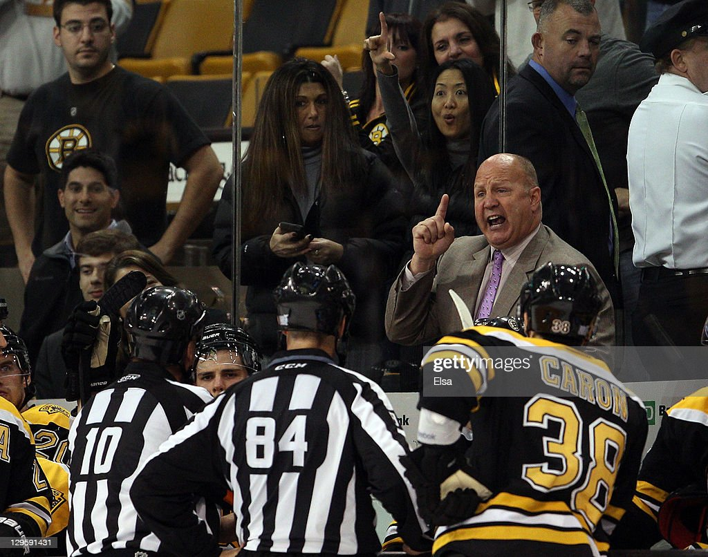 Head coach <a gi-track='captionPersonalityLinkClicked' href=/galleries/search?phrase=Claude+Julien&family=editorial&specificpeople=582124 ng-click='$event.stopPropagation()'>Claude Julien</a> of the Boston Bruins talks to referee Paul Devorski #10 and linesman Tony Sericolo #84 after Julien was tossed from the game in third period against the Carolina Hurricanes on October 18, 2011 at TD Garden in Boston, Massachusetts. The Carolina Hurricanes defeated the Boston Bruins 4-1.