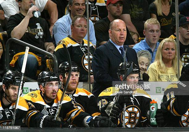 Head coach Claude Julien of the Boston Bruins watches his team from the bench during Game Four of the 2011 NHL Stanley Cup Final at TD Garden on June...