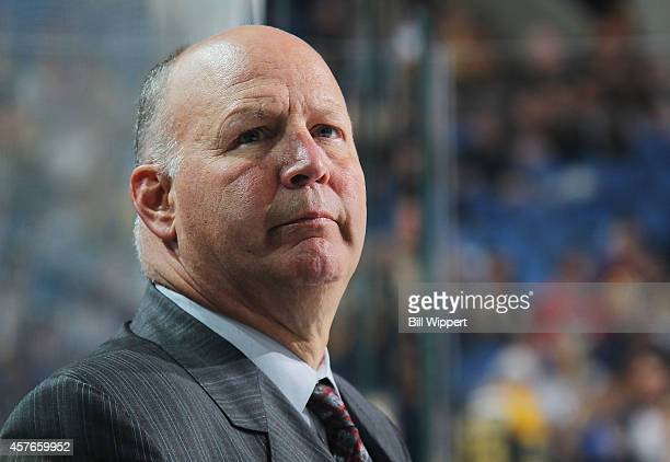 Head coach Claude Julien of the Boston Bruins watches the action against the Buffalo Sabres on October 18 2014 at the First Niagara Center in Buffalo...