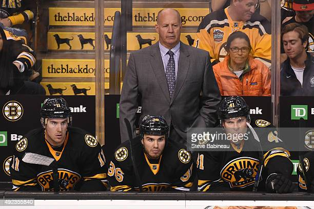 Head Coach Claude Julien of the Boston Bruins watches the play against the Tampa Bay Lightning at the TD Garden on October 12 2015 in Boston...