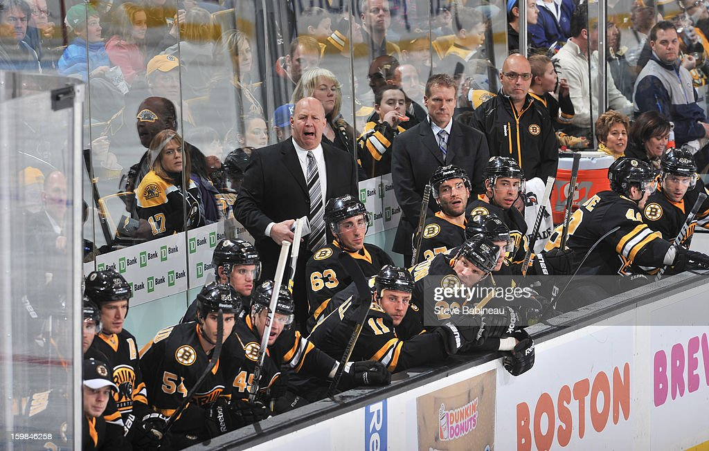 Head Coach Claude Julien of the Boston Bruins yells out to his team during a play against the Winnipeg Jets at the TD Garden on January 21, 2013 in Boston, Massachusetts.