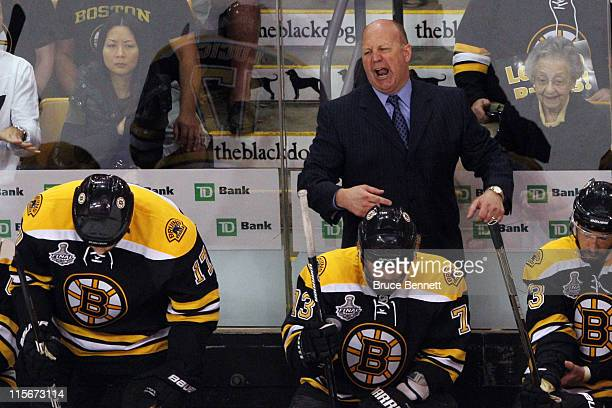 Head coach Claude Julien of the Boston Bruins yells to his team from the bench during Game Four against the Vancouver Canucks in the 2011 NHL Stanley...