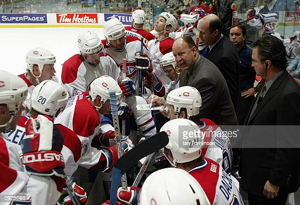 Head Coach Claude Julien of the Montreal Canadiens talks to his team during the game against the Calgary Flames at Pengrowth Saddledome on November...
