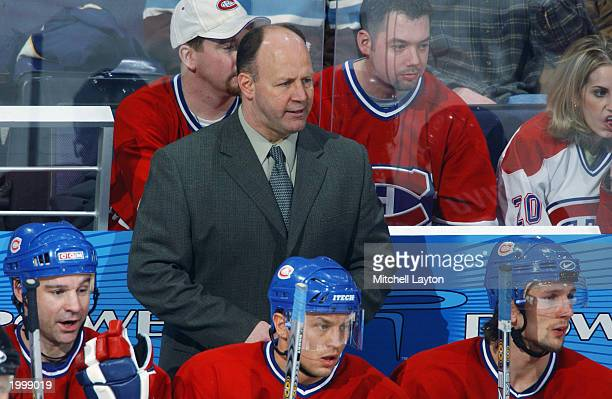 Head Coach Claude Julien of the Montreal Canadiens watches the NHL game against the Washington Capitals at MCI Center on February 9 2003 in...