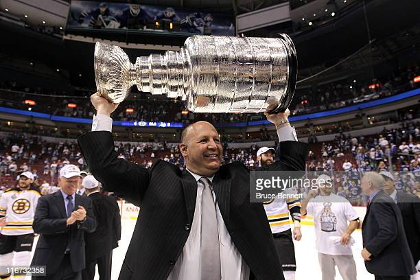 Head coach Claude Julien pose with the Stanley Cup after defeating the Vancouver Canucks in Game Seven of the 2011 NHL Stanley Cup Final at Rogers...