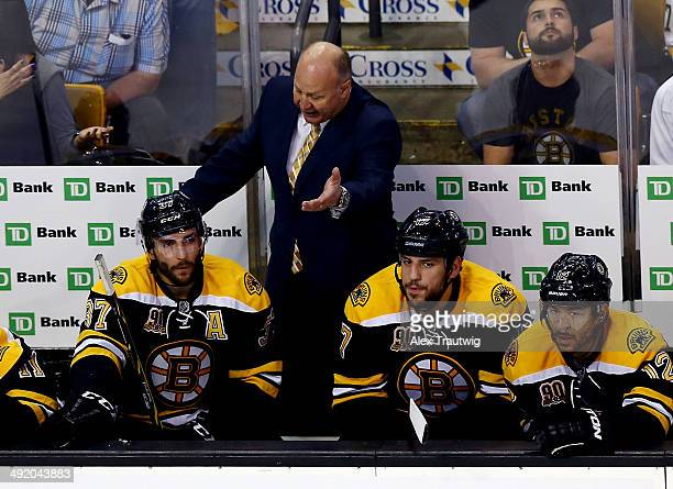 Head coach Claude Julien speaks with Patrice Bergeron and Milan Lucic of the Boston Bruins on the bench during Game Seven of the Second Round of the...
