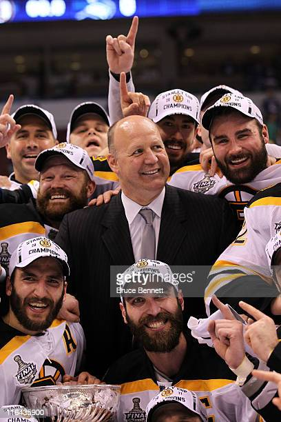 Head coach Claude Julien Tim Thomas Patrice Bergeron and Zdeno Chara of the Boston Bruins pose with the Stanley Cup after defeating the Vancouver...