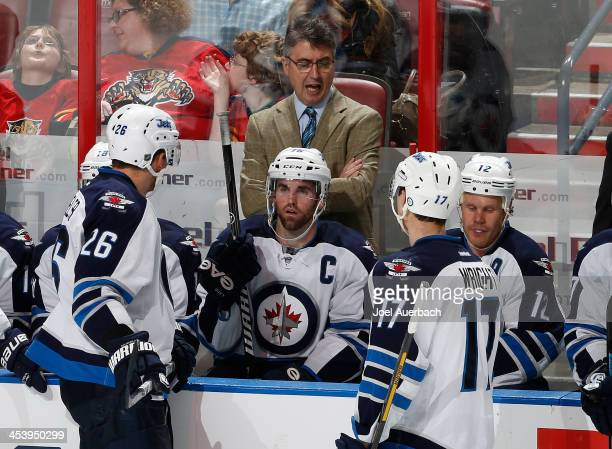 Head coach Claude Noel of the Winnipeg Jets directs the players during third period action against the Florida Panthers at the BBT Center on December...