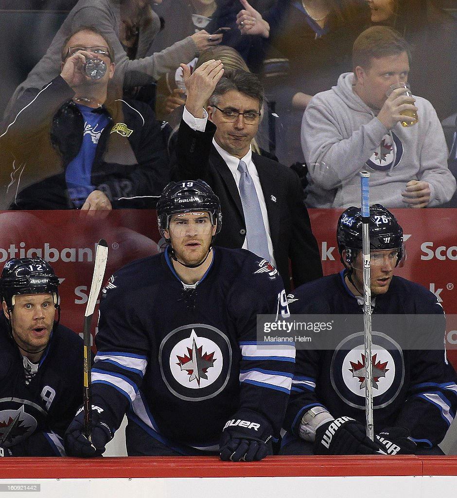 Head coach Claude Noel of the Winnipeg Jets gestures to a player as <a gi-track='captionPersonalityLinkClicked' href=/galleries/search?phrase=Olli+Jokinen&family=editorial&specificpeople=202946 ng-click='$event.stopPropagation()'>Olli Jokinen</a> #12, Jim Slater #19 and <a gi-track='captionPersonalityLinkClicked' href=/galleries/search?phrase=Blake+Wheeler&family=editorial&specificpeople=716703 ng-click='$event.stopPropagation()'>Blake Wheeler</a> #26 look on from the bench during second-period action on February 7, 2013 at the MTS Centre in Winnipeg, Manitoba, Canada.