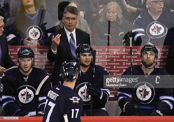 Head coach Claude Noel of the Winnipeg Jets gestures to James Wright in thirdperiod action of an NHL game against the St Louis Blues at the MTS...