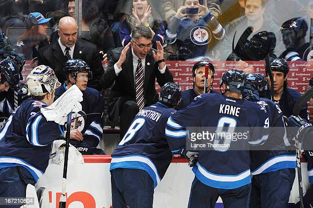Head Coach Claude Noel of the Winnipeg Jets gestures wildly as he instructs his team during a second period stoppage in play against the Tampa Bay...