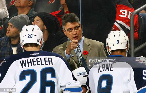 Head coach Claude Noel of the Winnipeg Jets gives instructions during a timeout against the New Jersey Devils at the Prudential Center on November 5...