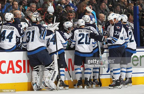 Head coach Claude Noel of the Winnipeg Jets gives instructions during a timeout in a game against the Toronto Maple Leafs on March 16 2013 at the Air...
