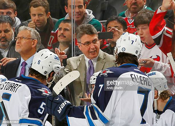 Head coach Claude Noel of the Winnipeg Jets gives instructions during a timeout against the New Jersey Devils during the game at the Prudential...