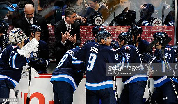 Head Coach Claude Noel of the Winnipeg Jets gives instructions to his players during a second period timeout against the Tampa Bay Lightning at the...