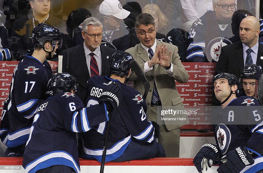 Head coach Claude Noel, of the Winnipeg Jets gives some direction from the bench during a break in play in third-period action against the Buffalo Sabres on April 9, 2013 at the MTS Centre in Winnipeg, Manitoba, Canada.
