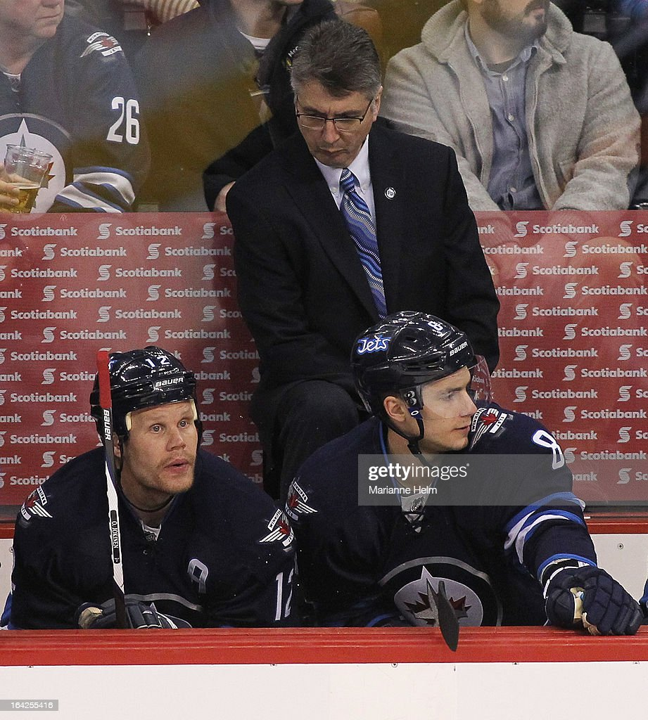Head coach Claude Noel of the Winnipeg Jets looks at <a gi-track='captionPersonalityLinkClicked' href=/galleries/search?phrase=Olli+Jokinen&family=editorial&specificpeople=202946 ng-click='$event.stopPropagation()'>Olli Jokinen</a> #12 as he sits beside <a gi-track='captionPersonalityLinkClicked' href=/galleries/search?phrase=Alexander+Burmistrov&family=editorial&specificpeople=4782297 ng-click='$event.stopPropagation()'>Alexander Burmistrov</a> #8 on the bench during third-period action against the Washington Capitals on March 21, 2013 at the MTS Centre in Winnipeg, Manitoba, Canada.