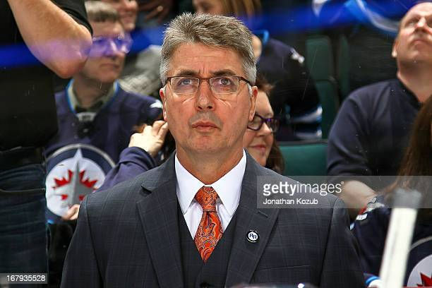 Head Coach Claude Noel of the Winnipeg Jets looks on from the bench prior to NHL action against the Montreal Canadiens at the MTS Centre on April 25...