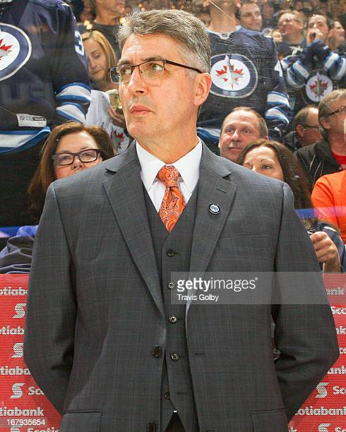 Head Coach Claude Noel of the Winnipeg Jets looks on from the bench prior to puck drop against the Montreal Canadiens at the MTS Centre on April 25...