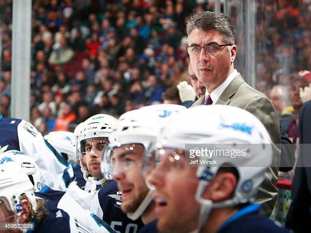 Head coach Claude Noel of the Winnipeg Jets looks on from the bench during their NHL game against the Vancouver Canucks at Rogers Arena December 22...