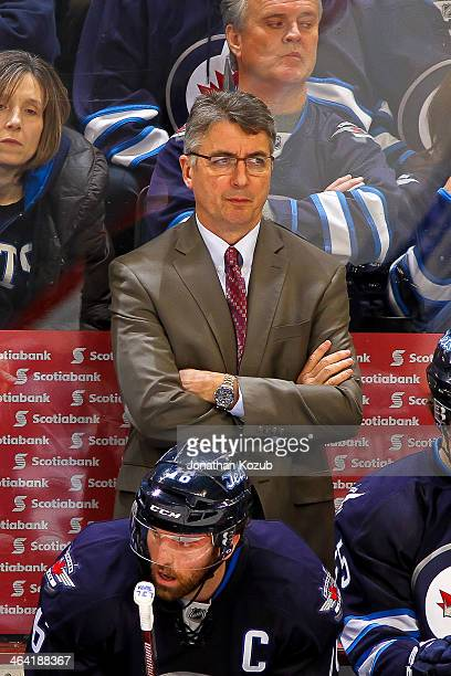 Head Coach Claude Noel of the Winnipeg Jets looks on from the bench during third period action against the Tampa Bay Lightning at the MTS Centre on...