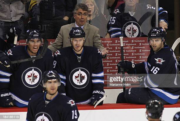 Head coach Claude Noel of the Winnipeg Jets talks to an official from the bench in the third period action of an NHL game at the MTS Centre on...