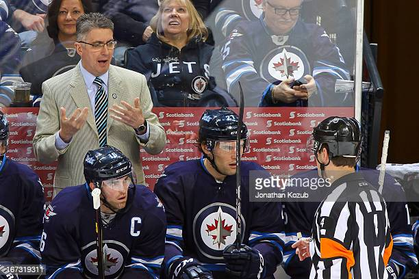 Head Coach Claude Noel questions referee Wes McCauley during the first period against the Carolina Hurricanes at the MTS Centre on April 18 2013 in...