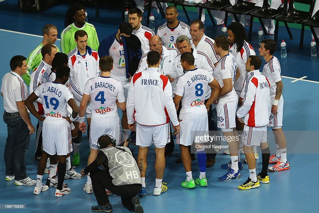 Head coach Claude Onesta of France speaks to the team during the round of sixteen match between Iceland and France at Palau Sant Jordi on January 20, 2013 in Barcelona, Spain.