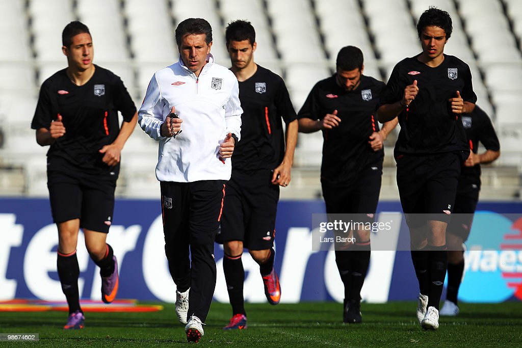 Head coach <a gi-track='captionPersonalityLinkClicked' href=/galleries/search?phrase=Claude+Puel&family=editorial&specificpeople=697176 ng-click='$event.stopPropagation()'>Claude Puel</a> warms up with his players during a Olympic Lyon training session at Stade de Gerland on April 26, 2010 in Lyon, France. Lyon will play against Bayern Muenchen at the UEFA Champions League semi final second leg match on April 27.