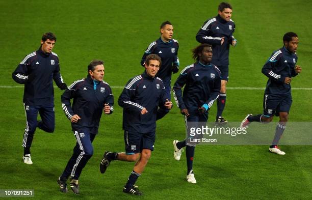 Head coach Claude Puel warms up with his players during a Olympique Lyon training session ahead of the UEFA Champions League match against FC Schalke...