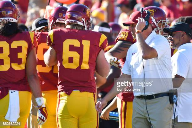 Head Coach Clay Helton congratulates USC Jake Olson after appearing in a college football game between the Oregon State Beavers and the USC Trojans...