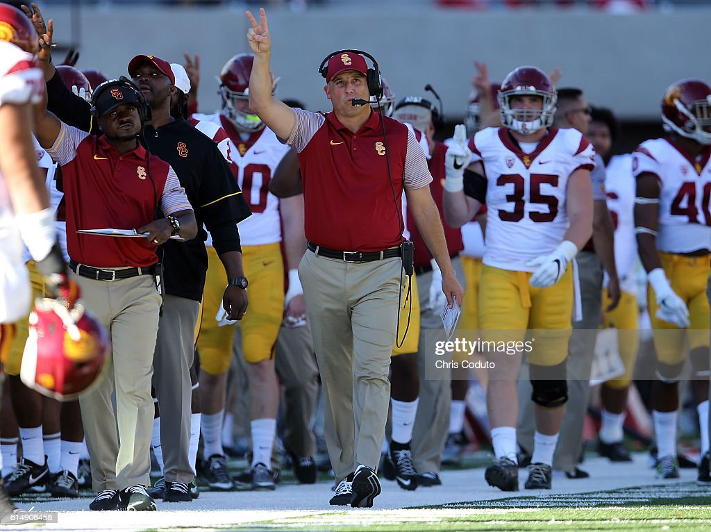 Head coach Clay Helton of the USC Trojans gestures on the sideline during the fourth quarter of the college football game against the Arizona Wildcats at Arizona Stadium on October 15, 2016 in Tucson, Arizona. USC won 48-14.