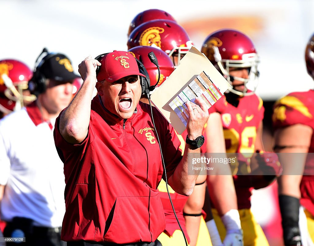 Head coach Clay Helton of the USC Trojans reacts on the sidelines during a 40-21 win over the UCLA Bruins at Los Angeles Memorial Coliseum on November 28, 2015 in Los Angeles, California.