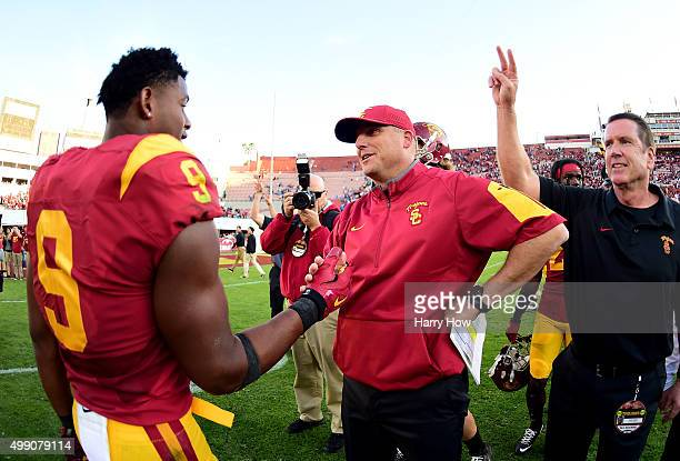 Head coach Clay Helton of the USC Trojans shakes hands with JuJu SmithSchuster after a 4021 win over the UCLA Bruins at Los Angeles Memorial Coliseum...
