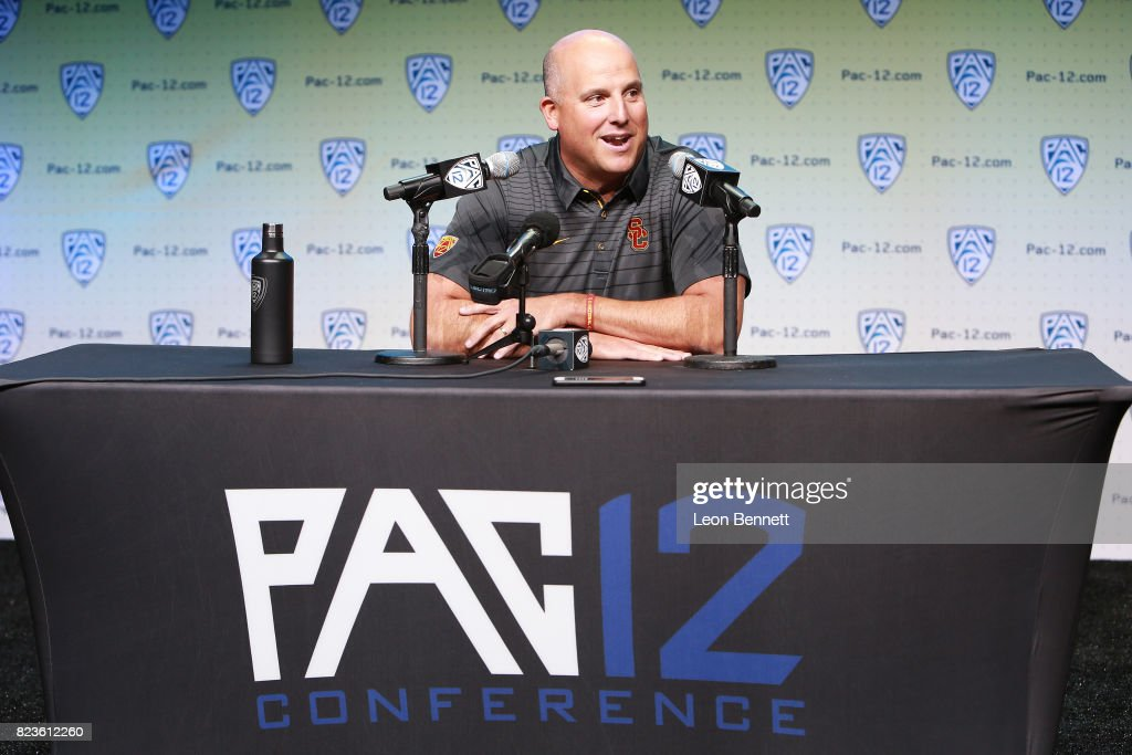 Head coach Clay Helton of the USC Trojans speaks to the media during PAC12 Media Days on July 27, 2017 in Hollywood, California.