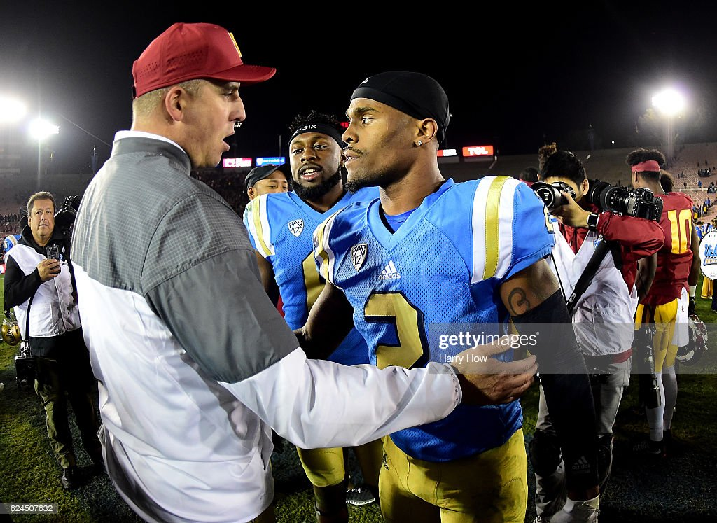 Head Coach Clay Helton of the USC Trojans talks with wide receiver Jaleel Wadood #2 of the UCLA Bruins after a Trojan 36-14 win at Rose Bowl on November 19, 2016 in Pasadena, California.