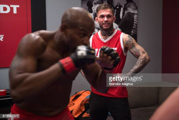 Head coach Cody Garbrandt watches as Eddie Gordon warms up before facing Tom Gallicchio during the filming of The Ultimate Fighter Redemption at the...